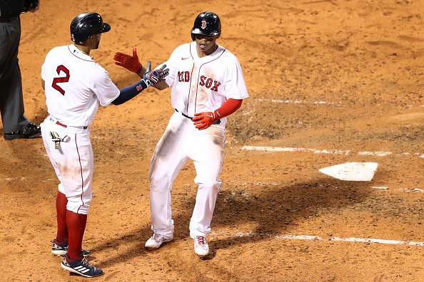 Rafael Devers homers, collects 3 RBI as Red Sox come back to top Braves, 9-5, in rain-filled night at Fenway Park; Nick Pivetta records season-high 9strikeouts